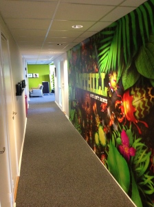 This mural is the most ostentatious display in the office, and even that is hidden en route to the kitchen.